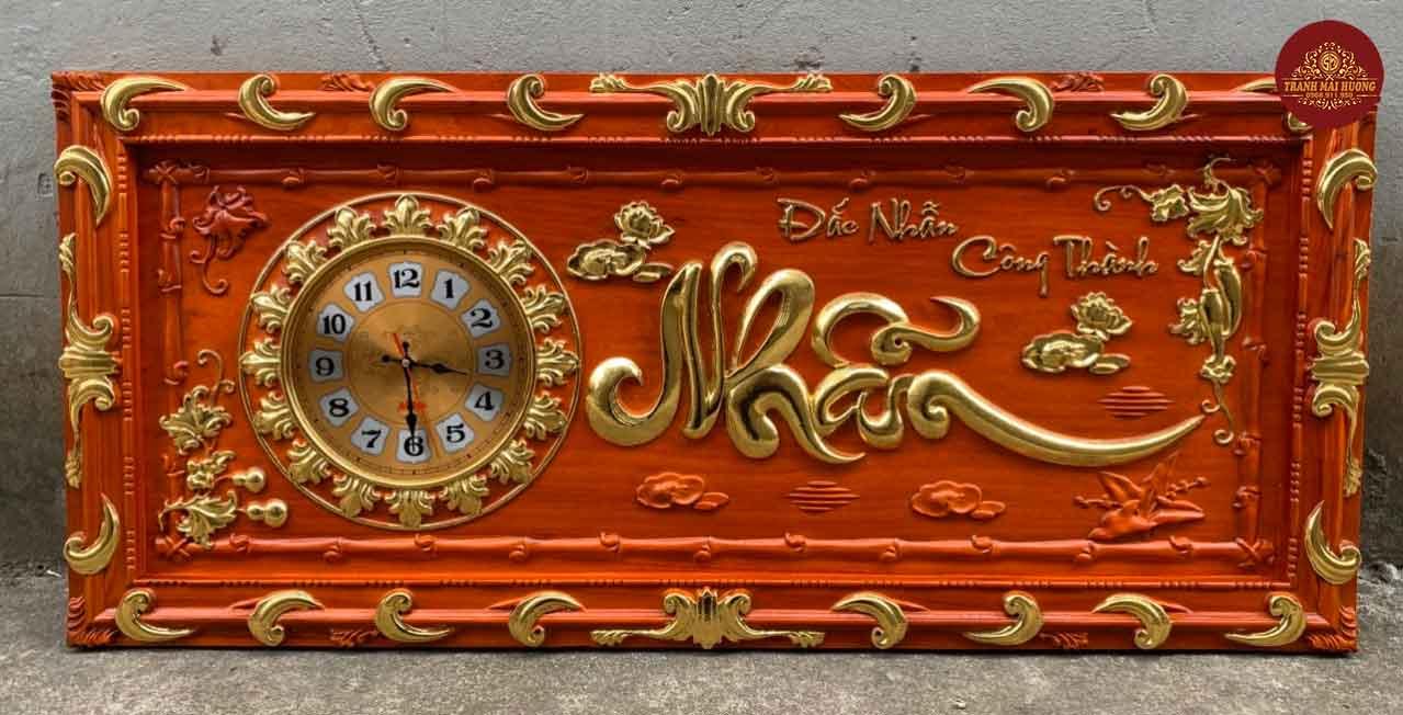 Tranh đồng hồ gỗ hương chữ Nhẫn dát vàng. KT: 48x108x3